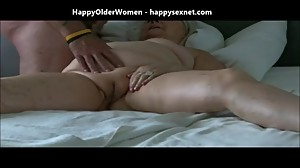 Granny fingering her pussy and eaiting..