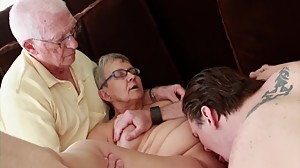 Granny fucked by young dude while her..