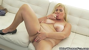 Busty grandma Pem loves stuffing her old..