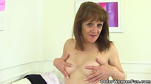 English gilf Pandora peels off tights..