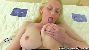 British milf Fiona fingers her soaking..