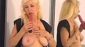 Mature and busty blonde woman pokes her..