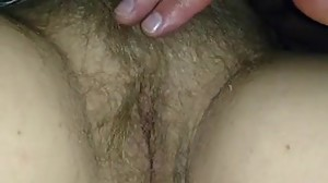 She fingering her hairy pussy