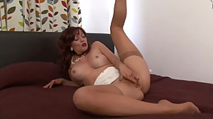 Mature redhead plays with pussy