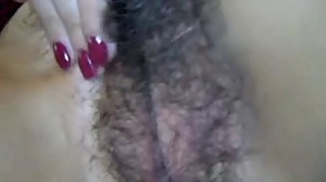 Hairy pussy on mature lady getting toyed..