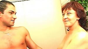 Mature brunette boss seducing her employee