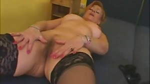 60 year old redhead masturbates and gets..