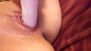 Girl fucks her 18 year old pussy while..