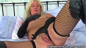 British milf Ellen feeds her hungry cunt..