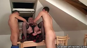 She takes two cocks into her old pussy..