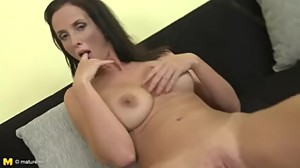 Big titted brunette MILF fingering her..