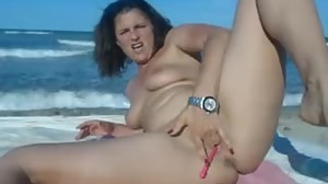Horny milf on the beach