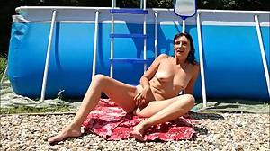 Sexy Milf Slut Strips in Pool then..
