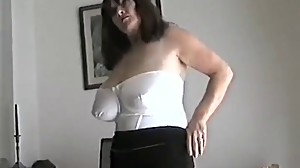 Mature milf with large tits rubbing her..