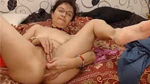 Hot grandma fingering her pussy and..