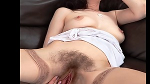 Mature poses with her hairy pussy