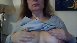 Old gal teases her pussy, rubs tits